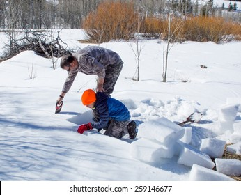 Construction Stages igloo - Eskimo dwelling of ice and snow. Adult and child cut bricks of dense snow