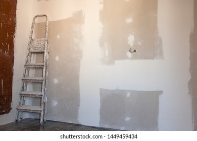 Construction stepladder. Ladder. Drywall Putty walls. Apartment repair. Home repairs. Construction works.