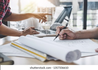 Construction and structure concept of Engineer or architect meeting for project working with partner and engineering tools on model building and blueprint in working site.