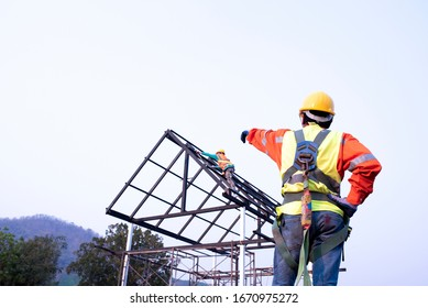 Construction team engineers wear steel roof safety inspection uniforms for roofing industry concepts.