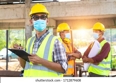 [Construction Teamwork ] Team of construction engineers and three architects are ready to wear medical masks. Corona or Covid-19 wear masks during the design of construction. New normal.