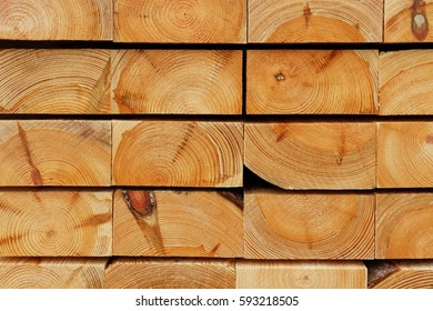 Construction Timber Background: Cutting Edges of Piled Pine Thick Boards