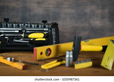 construction tooling on wooden board maintenance concept.