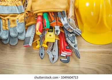 Construction tooling tool belt safety gloves hard hat