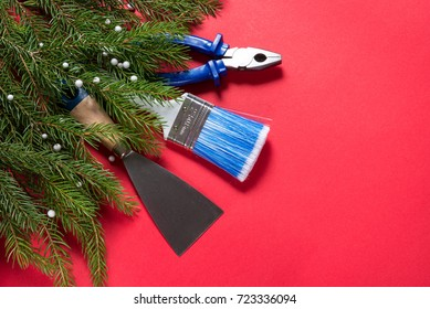 Construction tools and Christmas tree on red background, copy space