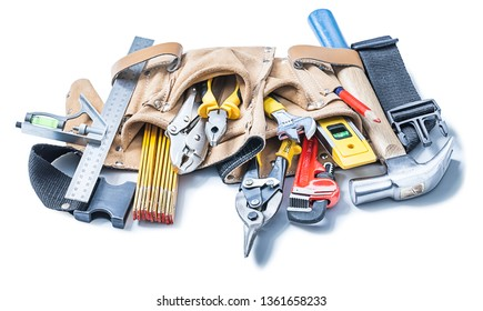 construction tools in leather toolbelt isolated on white