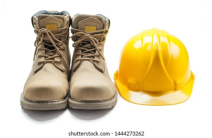 construction tools leather working boots and yellow helmet isolated on white