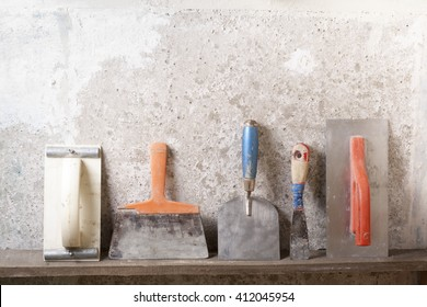 Construction tools on concrete background. Copy space for text. Set of assorted plaster trowel tools and spatula . Top view
