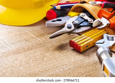 construction tools in tool belt and on wooden board