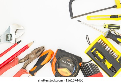 Construction tools - wire cutters and a wrench on a white background with space for text