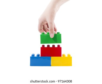 Construction toys and women's hands.