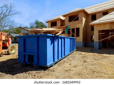 Construction trash dumpsters on metal container, house renovation.