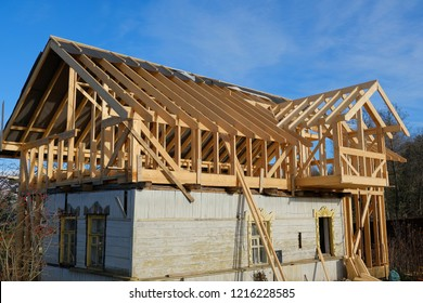 construction of a two-storey frame house outside the city