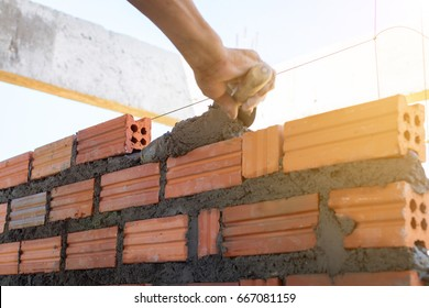 Construction wall Building with brick and cement at daytime. selective focus