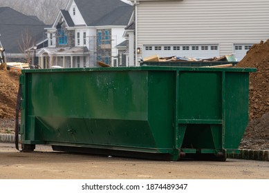 construction waste in a large green container metal iron