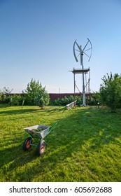 Construction wheelbarrow near magnetic wind turbine