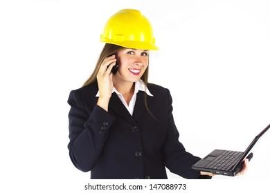 Construction woman on laptop talking on phone