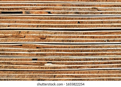Construction Wood Texture Background: Weathered Cross Section of Piled Plywood Panels - Detail
