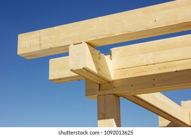 Construction of a wooden beam. Assembling. Angle of log house