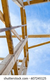 Construction of a wooden eco house against the sky.