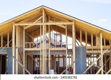Construction of a wooden house. Beam. Blue Sky. Architecture.