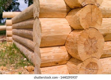 Construction of the wooden house from round logs.  Blockhouse logs close up.