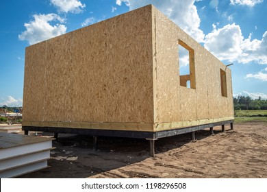 Construction of a wooden house of SIP panels.