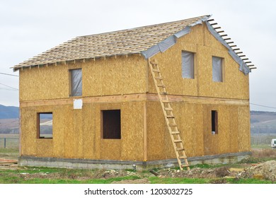 Construction of a wooden house of SIP panels. Element of building design.