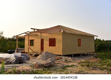 Construction wooden house of  Structural Insulated Panels (SIPs) turnkey ready project. Unfinished Wood residential building of panelized wall in country area. Sip house with timber frame