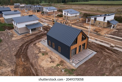 Construction wooden house of  Structural Insulated Panels (SIPs) turnkey. Unfinished Wood residential home of panelized wall in country area. Sip house with timber frame. Suburb houses. Soft focus