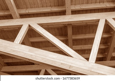 The construction of the wooden roof. Detailed photo of a wooden roof overlap construction. - Shutterstock ID 1677383659