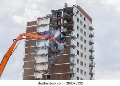 Construction work demolishing high rise flats signifying housing and regeneration