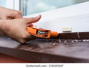 Construction work - installation of rivets. Window tint repair. Plastic windows.