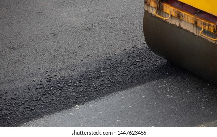 Construction work for a road and highway repair,Concept: Transportation symbol for vehicle safety,Worker operating asphalt road city