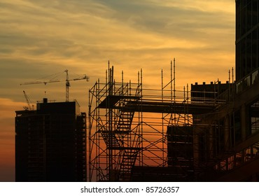 Construction work site on the sunset background