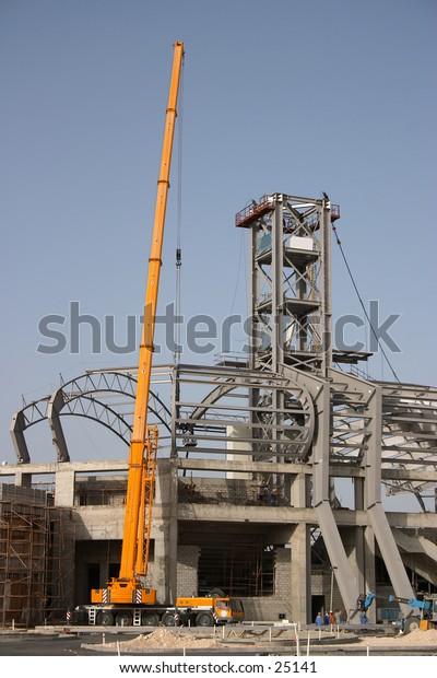 Construction work under way on a sports stadium in Qatar, Arabia, spring 2004