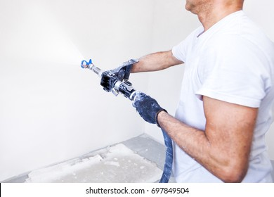 Construction worker applies a finishing coat