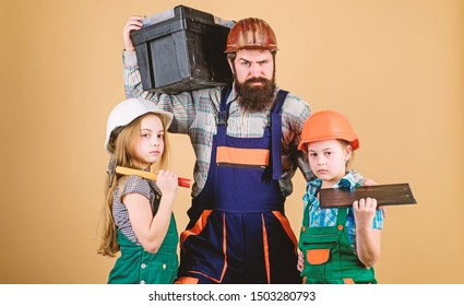 construction worker assistant. Builder or carpenter. Repairman in uniform. Foreman. Father and daughter in workshop. Family teamwork. Repair. Bearded man with little girls. problem is right here.