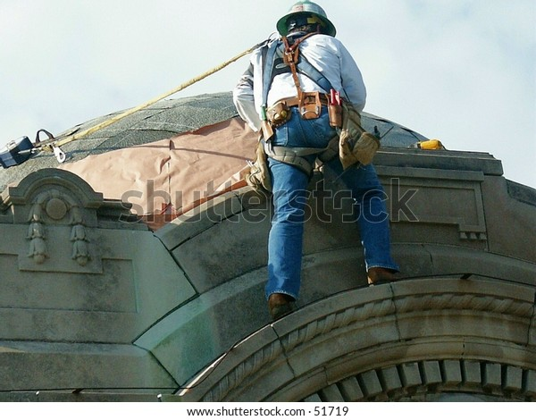 construction worker attached to dome