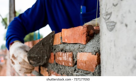 Construction worker, Bricklayer, constructing brick wall