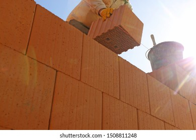 Construction worker (bricklayer) working on the construction site