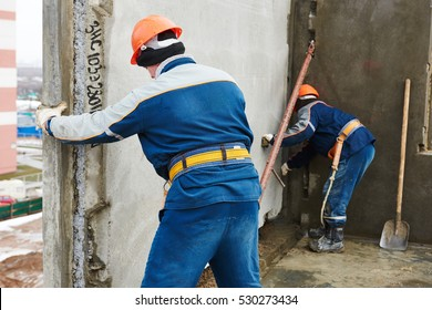 Construction worker. Builders concreter joiners at work
