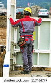 construction worker at a building formwork for concrete work. construction of an industrial building