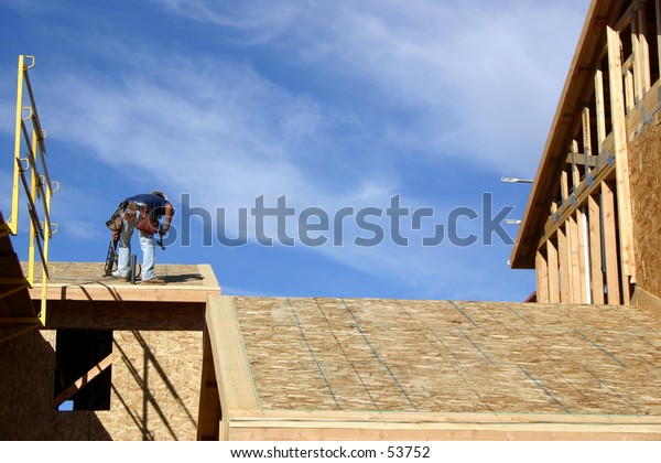 A construction worker building a house.