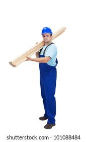 Construction worker carrying wooden planks - isolated