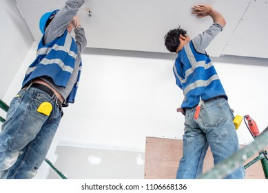 Construction worker ceiling work