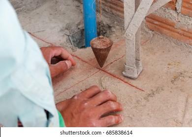 Construction Worker check Plumb Bob