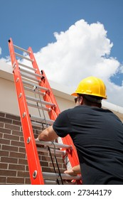 Construction worker climbing a ladder up to the roof.
