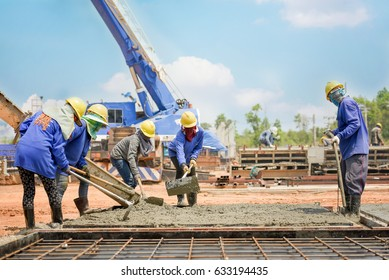 Construction worker Concrete pouring during commercial concreting floors of building in construction site and Civil Engineer or structural engineer inspec work