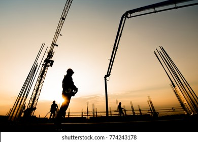 Construction worker Concrete pouring during commercial concreting floors of building in construction site and Civil Engineer or Construction engineer inspec work